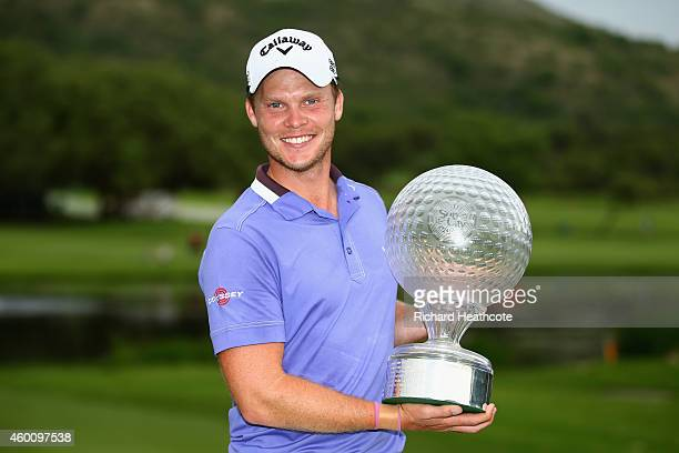 Danny Willett of England poses with the trophy after securing victory during the final round of the Nedbank Golf Challenge at the Gary Player Country...