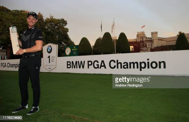 Danny Willett of England poses with the trophy after winning the BMW PGA Championship at Wentworth Club on September 22, 2019 in Virginia Water,...