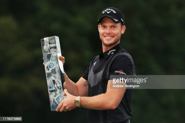 Danny Willett of England poses with the winners trophy following victory at the BMW PGA Championship at Wentworth Golf Club on September 22 2019 in...