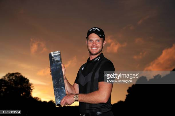 Danny Willett of England poses with the winners trophy following victory in the BMW PGA Championship at Wentworth Golf Club on September 22, 2019 in...