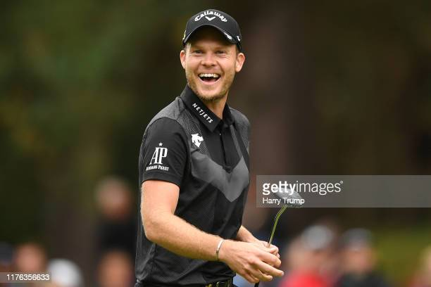 Danny Willett of England reacts after he putts in on the 11th green during Day 4 of the BMW PGA Championship at Wentworth Golf Club on September 22,...