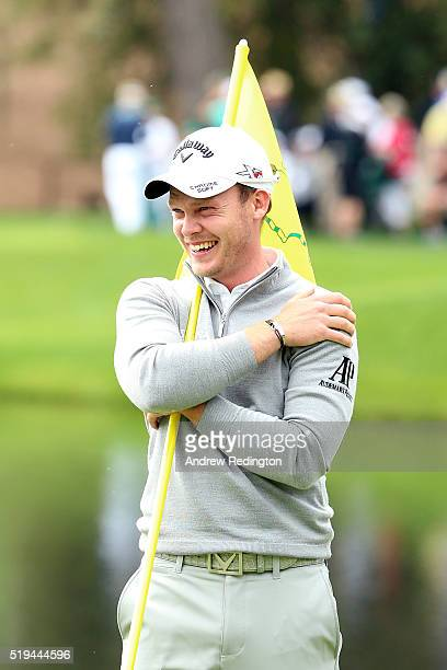 Danny Willett of England reacts during the Par 3 Contest prior to the start of the 2016 Masters Tournament at Augusta National Golf Club on April 6...