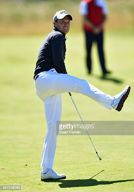 Danny Willett of England reacts to his second shot on the 12th during the first round on day one of the 145th Open Championship at Royal Troon on...