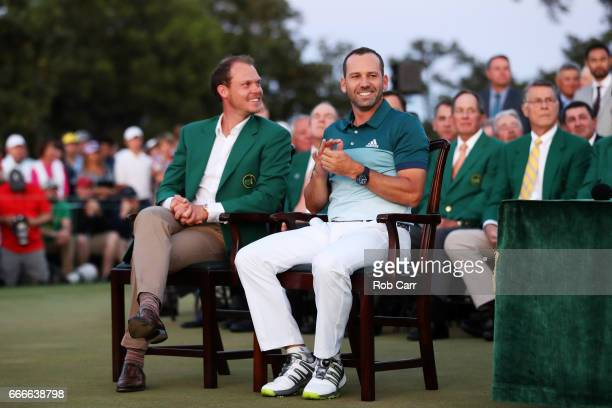 Danny Willett of England sits alongside Sergio Garcia of Spain during the Green Jacket ceremony after Garcia won in a playoff during the final round...