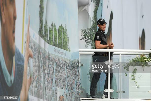 Danny Willett of England sprays champagne from the spectator village balcony as he celebrated his win after the final round of the BMW PGA...
