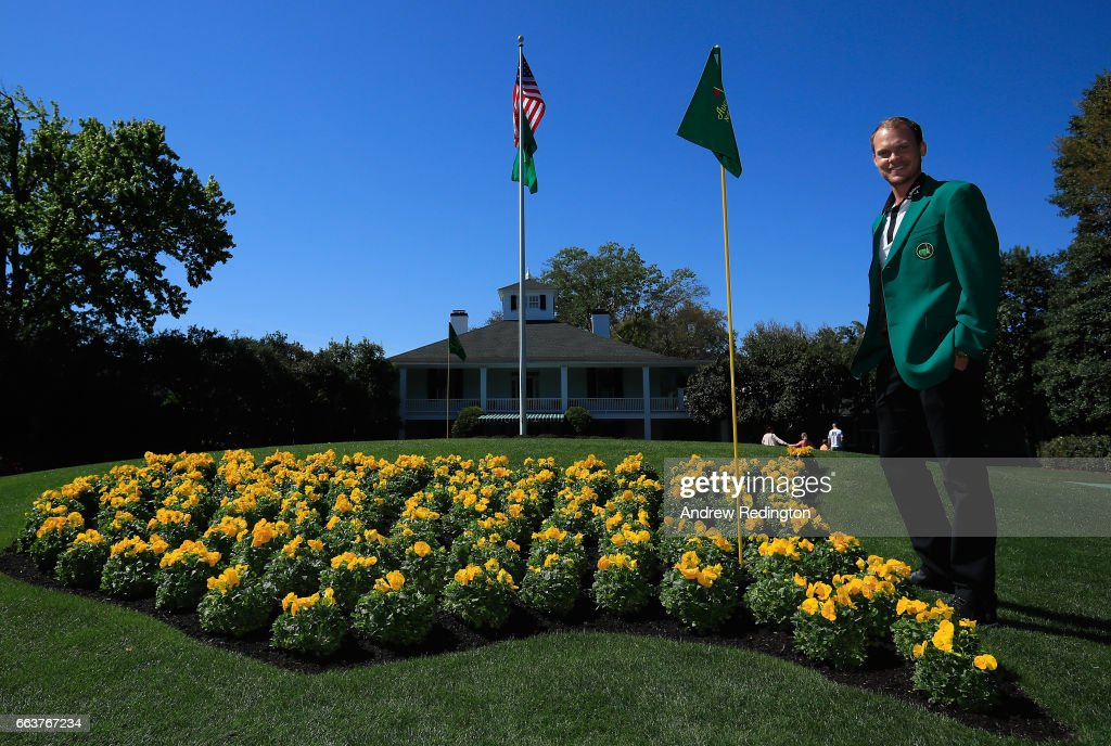 Danny Willett of England, the defending champion, is pictured wearing his green jacket in front of the clubhouse during the Drive, Chip and Putt Championship at Augusta National Golf Club at Augusta National Golf Club on April 2, 2017 in Augusta, Georgia.