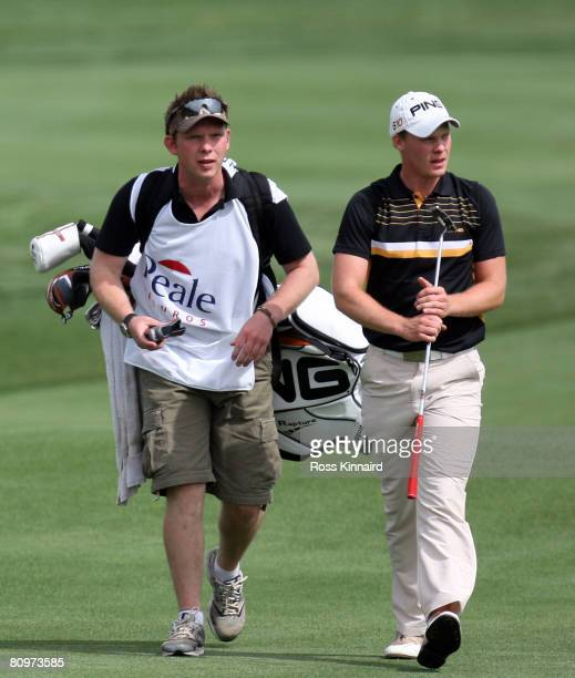 Danny Willett of England the number one amateur in the world walks with his caddie and brother Matthew on the par four 18th hole during the third...