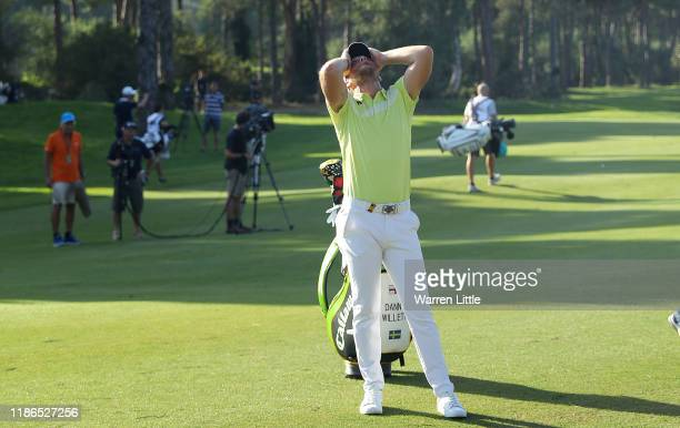 Danny Willett of England tries in vain to find his ball which got stuck up a tree on the 13th hole during the third round of the Turkish Airlines...