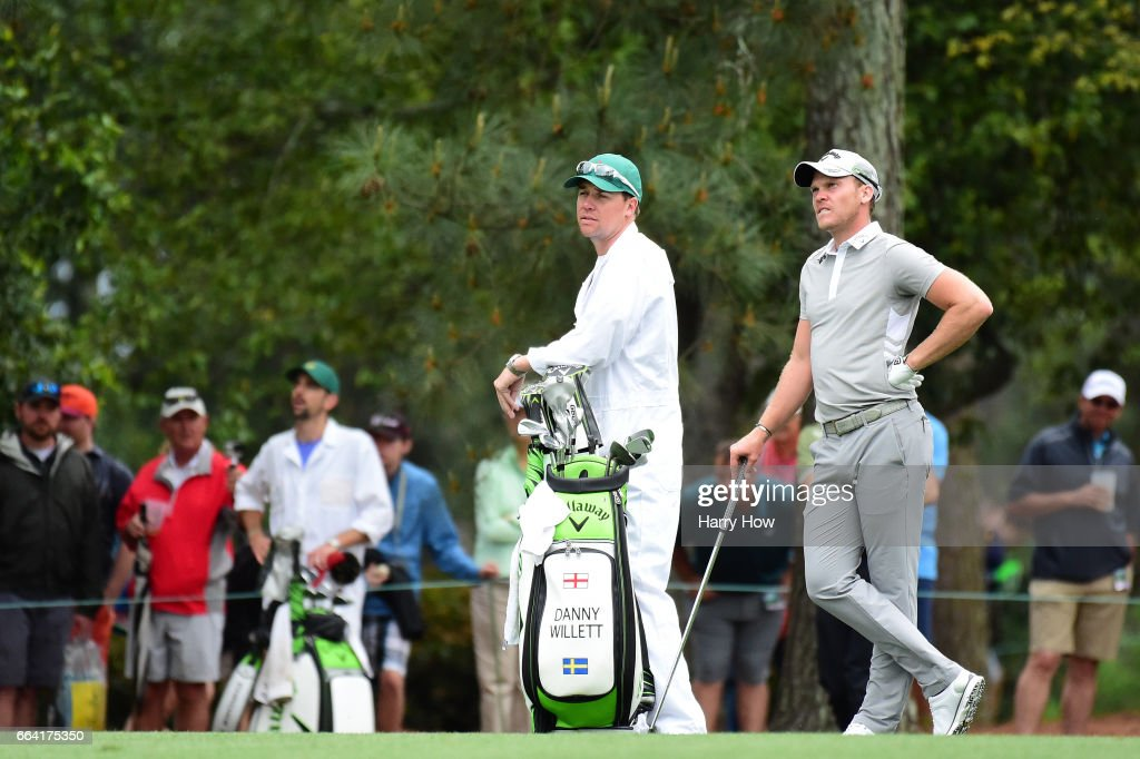 Danny Willett of England waits alongside his caddie during a practice round prior to the start of the 2017 Masters Tournament at Augusta National Golf Club on April 3, 2017 in Augusta, Georgia.