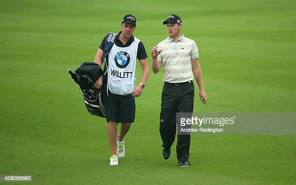 Danny Willett of England walks with his caddie on the ninth hole during the first round of the BMW Masters at Lake Malaren Golf Club on October 30...