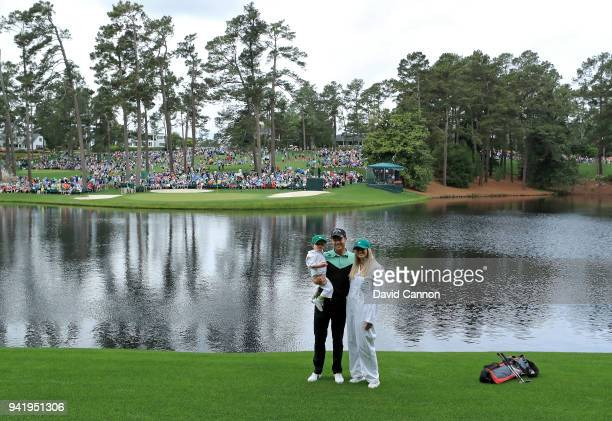 Danny Willett of England, wife Nicole and son Zachariah James Willett pose for a photo during the Par 3 Contest prior to the start of the 2018...