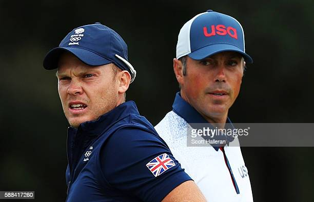 Danny Willett of Great Britain and Matt Kuchar of the United States stand on the third tee during the first round of men's golf on Day 6 of the Rio...