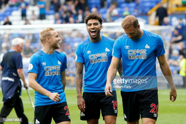 Danny Williams, Alex Pritchard and Laurent Depoitre of Huddersfield Town during the Premier League match between Everton FC and Huddersfield Town at...