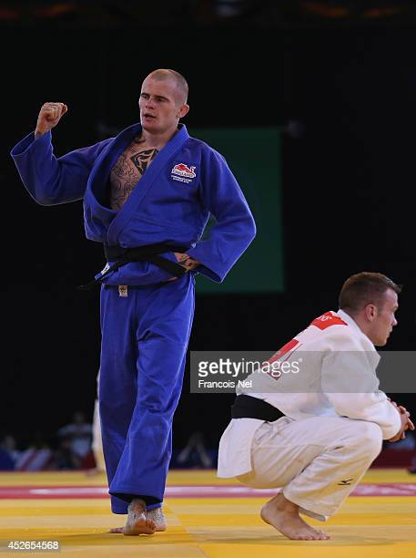 Danny Williams of England celebrates after winning against Arnie Dickins of Australia in the Men's Judo 73 kg at SECC Precinct during day two of the...