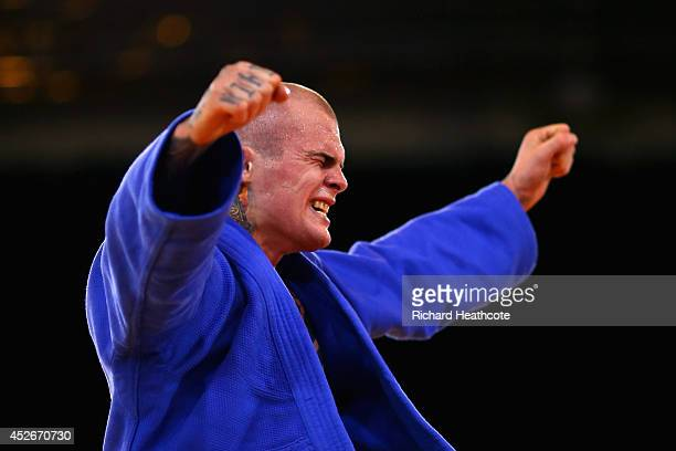 Danny Williams of England celebrates winning gold in the Men's 73kg Final Gold Medal Contest against Adrian Leat of New Zealand at SECC Precinct...