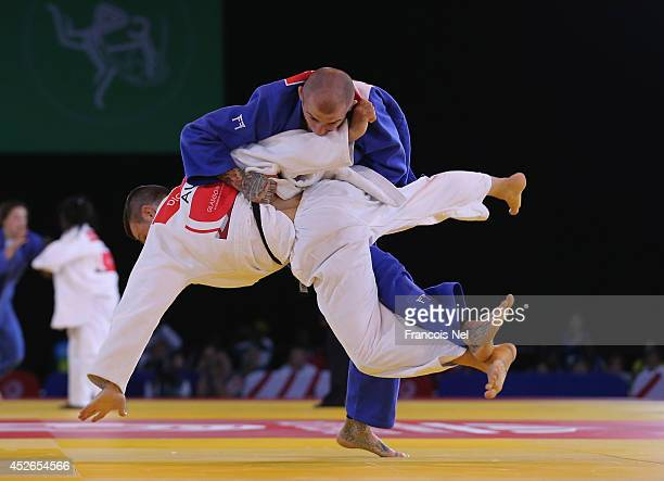 Danny Williams of England competes against Arnie Dickins of Australia competes against in the Men's Judo 73 kg at SECC Precinct during day two of the...