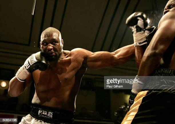 Danny Williams of England lands a left on Augustine N'Gou of Ivory Coast during the bout for the Vacant WBU International Heavyweight Championship on...