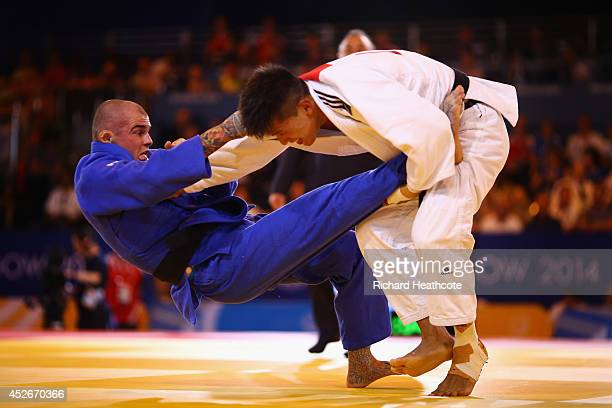 Danny Williams of England on his way to winning gold in the Men's 73kg Final Gold Medal Contest against Adrian Leat of New Zealand at SECC Precinct...