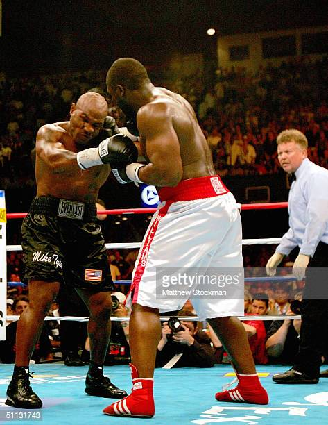 Danny Williams of Great Britain connects with Mike Tyson during the fourth round July 30 2004 at Freedom Hall in Louisville Kentucky
