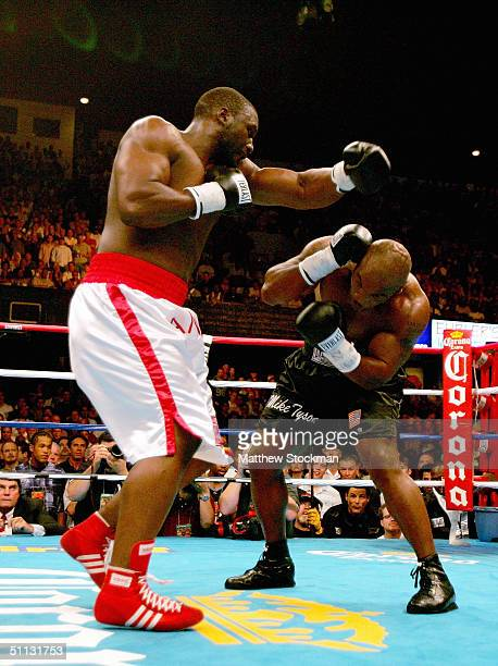 Danny Williams of Great Britain connects with Mike Tyson in round two July 30 2004 at Freedom Hall in Louisville Kentucky