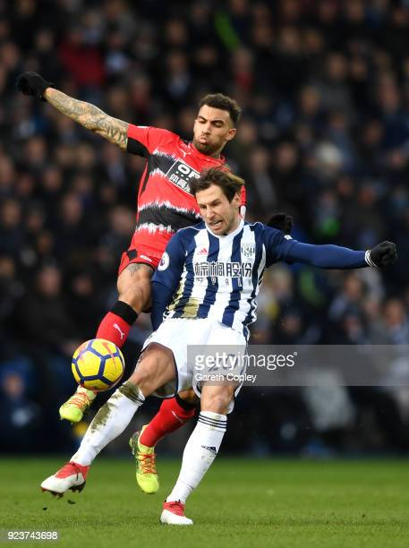 Danny Williams of Huddersfield Town and Grzegorz Krychowiak of West Bromwich Albion battle for the ball during the Premier League match between West...