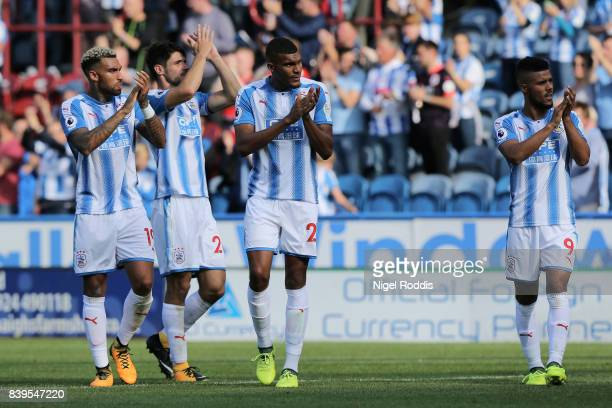 Danny Williams of Huddersfield Town and his Huddersield Town team mates show appreciation to the fans after the Premier League match between...
