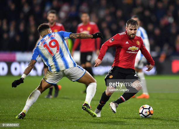 Danny Williams of Huddersfield Town and Luke Shaw of Manchester United battle for the ball during the The Emirates FA Cup Fifth Round between...