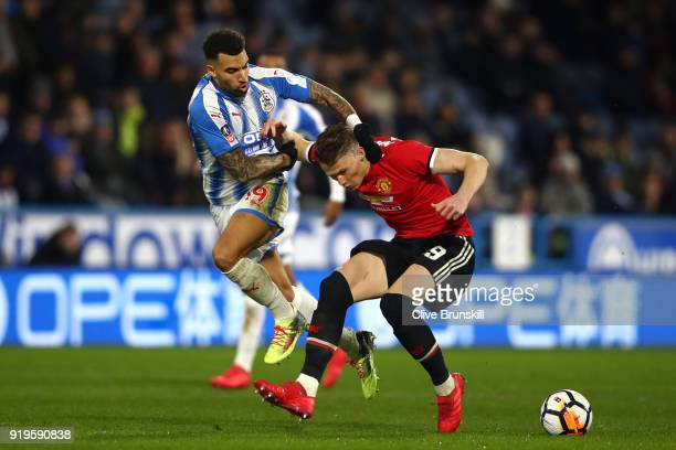 Danny Williams of Huddersfield Town and Scott McTominay of Manchester United clash during the The Emirates FA Cup Fifth Round between Huddersfield...
