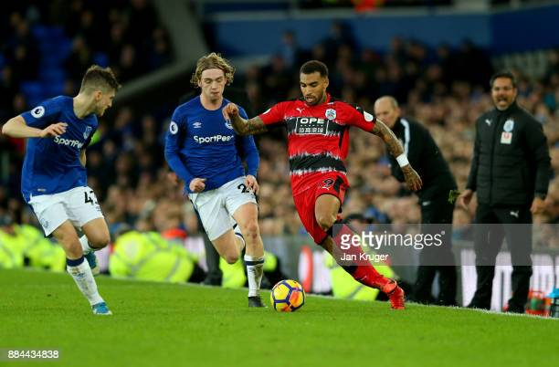 Danny Williams of Huddersfield Town attempts to get past Jonjoe Kenny of Everton during the Premier League match between Everton and Huddersfield...