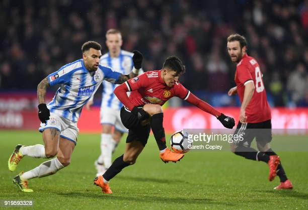 Danny Williams of Huddersfield Town chases down Alexis Sanchez of Manchester United during the The Emirates FA Cup Fifth Round between Huddersfield...
