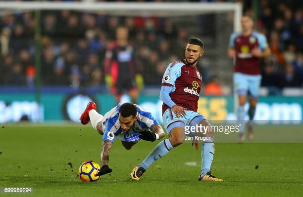 Danny Williams of Huddersfield Town clashes with Nahki Wells of Burnley during the Premier League match between Huddersfield Town and Burnley at John...