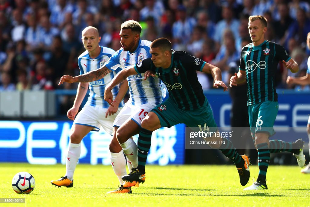 Danny Williams of Huddersfield Town in action with Oriel Romeu of Southampton during the Premier League match between Huddersfield Town and Southampton at the John Smith's Stadium on August 26, 2017 in Huddersfield, England.