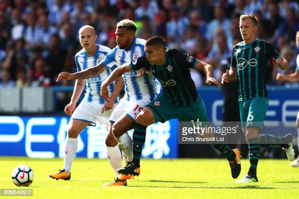 Danny Williams of Huddersfield Town in action with Oriel Romeu of Southampton during the Premier League match between Huddersfield Town and...