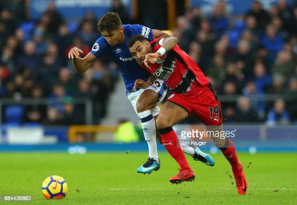 Danny Williams of Huddersfield Town is challenged by Dominic CalvertLewin of Everton during the Premier League match between Everton and Huddersfield...