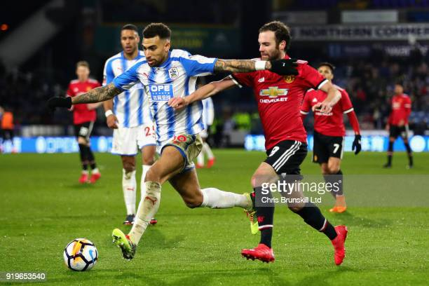 Danny Williams of Huddersfield Town is challenged by Juan Mata of Manchester United during the Emirates FA Cup Fifth Round match between Huddersfield...