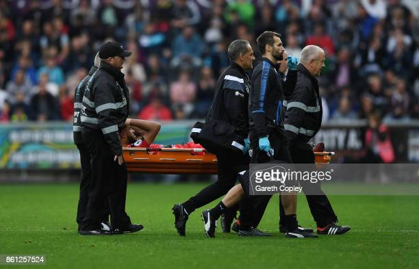 Danny Williams of Huddersfield Town is taken off injured during the Premier League match between Swansea City and Huddersfield Town at Liberty...