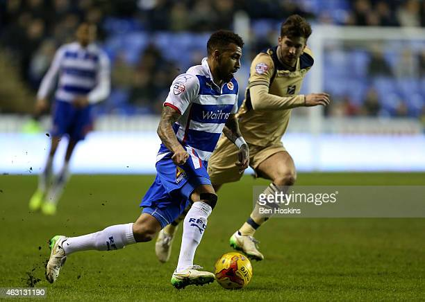 Danny Williams of Reading advances under pressure from Luke Murphy of Leeds during the Sky Bet Championship match between Reading and Leeds United at...