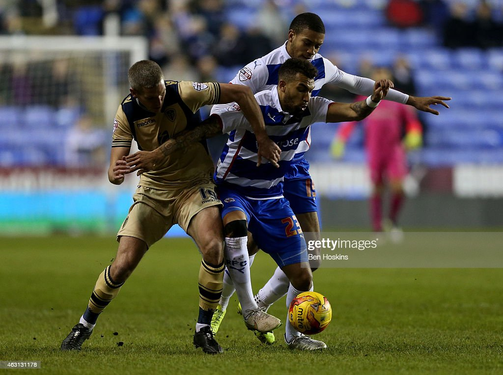 Danny Williams of Reading battles with Steve Morrison of Leeds during the Sky Bet Championship match between Reading and Leeds United at Madejski Stadium on February 10, 2015 in Reading, England.
