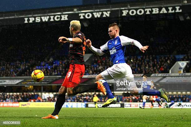 Danny Williams of Reading FC and Ryan Tunnicliffe of Ipswich Town battle for the ball during the Sky Bet Championship match between Ipswich Town and...