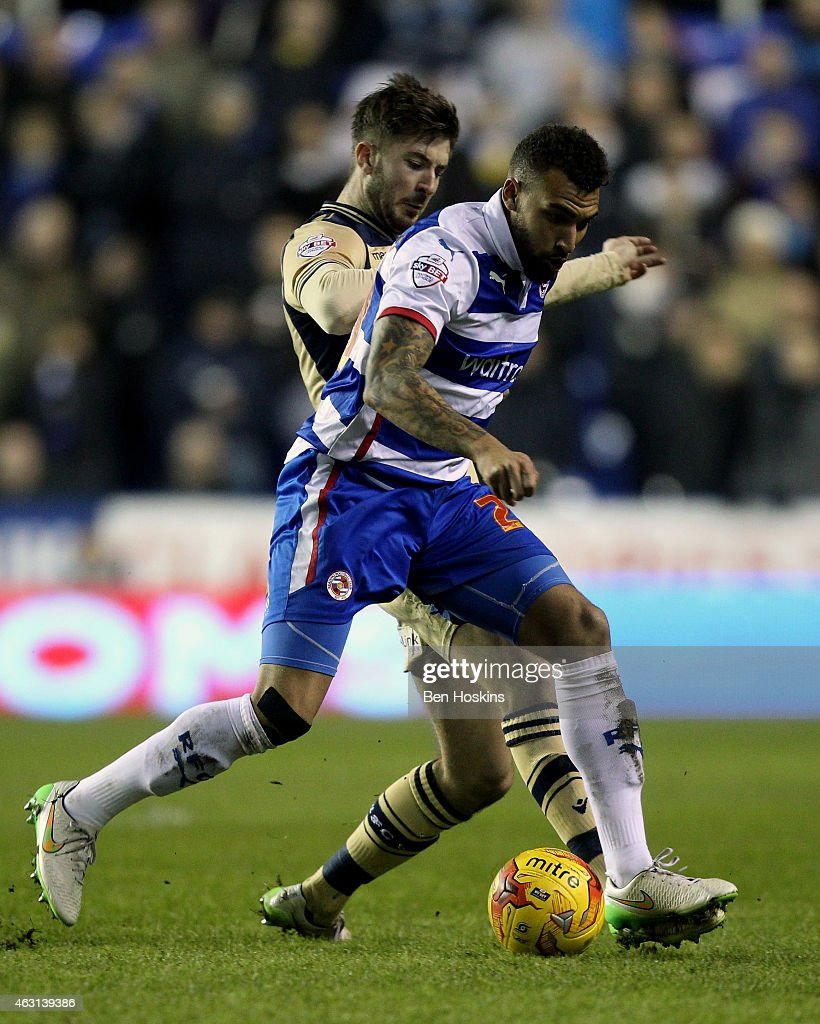 Danny Williams of Reading holds off pressure from Luke Murphy of Leeds during the Sky Bet Championship match between Reading and Leeds United at Madejski Stadium on February 10, 2015 in Reading, England.