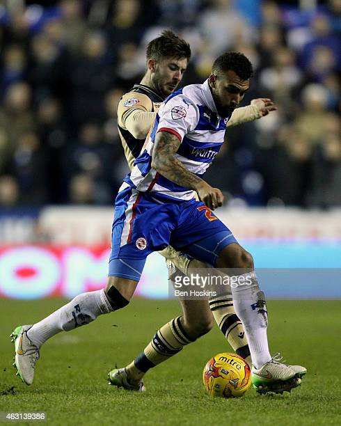 Danny Williams of Reading holds off pressure from Luke Murphy of Leeds during the Sky Bet Championship match between Reading and Leeds United at...