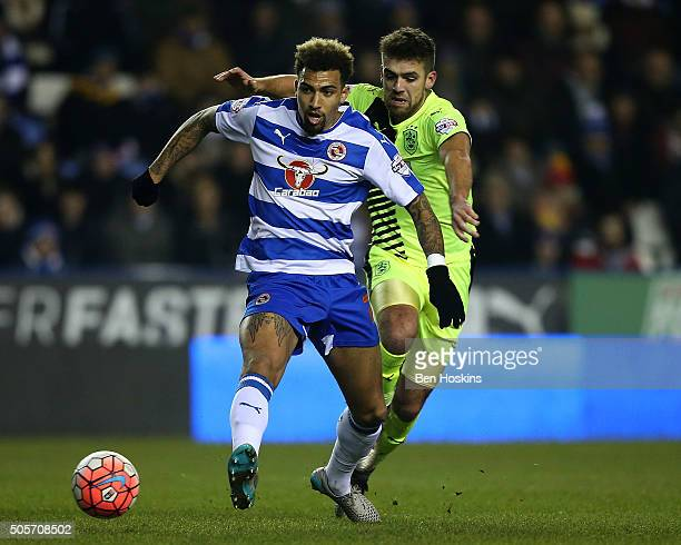 Danny Williams of Reading holds off pressure from Tommy Smith of Huddersfield during The Emirates FA Cup Second Round match between Reading and...