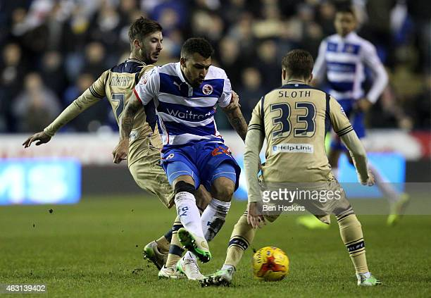Danny Williams of Reading passes under pressure from Luke Murphy and Casper Sloth of Leeds during the Sky Bet Championship match between Reading and...
