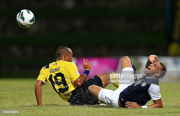 Danny Williams of the United States dives for a ball against George Luke Anthony of Antigua and Barbuda during a World Cup Qualifying game at Sir...