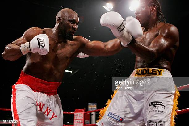 Danny Williams throws a left at Audley Harrison during the Vacant Commonwealth Heavyweight Championship fight at the ExCel Centre on December 10 2005...