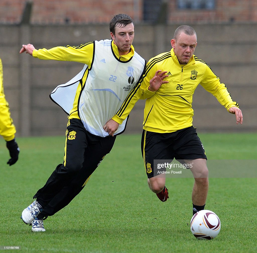 Danny Wilson and Jay Spearing (R) of Liverpool FC compete for the ball during a training session ahead of their UEFA Europa League round of 16 second leg match against Braga at the Melwood Training Ground on March 16, 2011 in Liverpool, England.