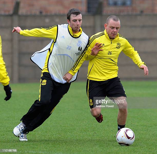 Danny Wilson and Jay Spearing of Liverpool FC compete for the ball during a training session ahead of their UEFA Europa League round of 16 second leg...