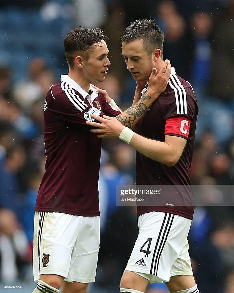 Danny Wilson and Sam Nicholson of Hearts celebrate at full time during the Scottish Championship Opening League Match between Rangers and Hearts, at Ibrox Stadium on August 10, 2014 Glasgow, Scotland.