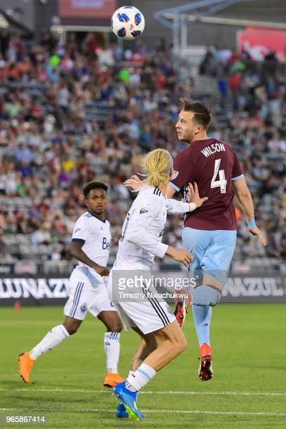 Danny Wilson of Colorado Rapids heads the ball over Brek Shea of Vancouver Whitecaps at Dick's Sporting Goods Park on June 1 2018 in Commerce City...