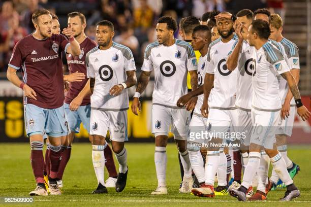 Danny Wilson of Colorado Rapids yells towards Miguel Ibarra of Minnesota United at Dick's Sporting Goods Park on June 23, 2018 in Commerce City,...